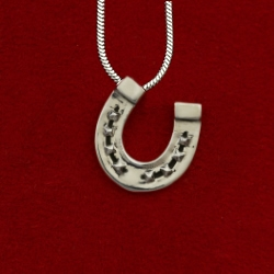 Silver horseshoe pendant necklace from Jane Heart Jewelry